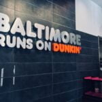 """Sign inside Dunkin' at Belvedere Square that reads """"Baltimore Runs on Dunkin""""."""